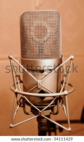 Microphone in a sound enclosure booth, close up - stock photo