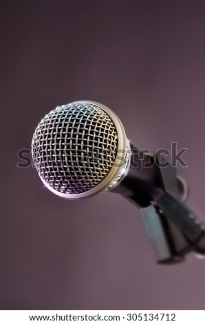 Microphone in a studio with glittering lights and effects