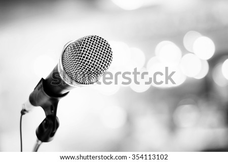 microphone in concert hall or conference room;black and white tone - stock photo