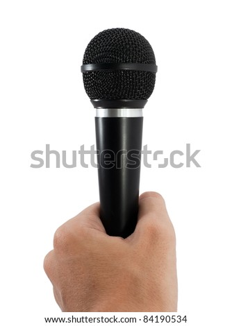 Microphone in hand over white background - stock photo