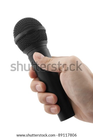 Microphone in hand with clipping path - stock photo