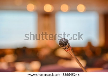 Microphone in meeting room before a conference. - stock photo