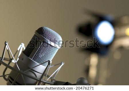 Microphone in studio. Dark blue light. - stock photo