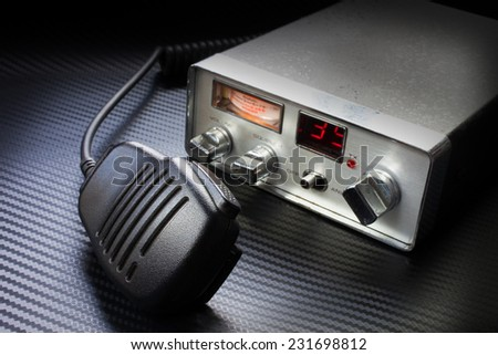 Microphone in the foreground with a radio behind - stock photo