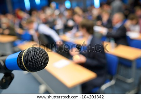 Microphone in the lecture hall. - stock photo