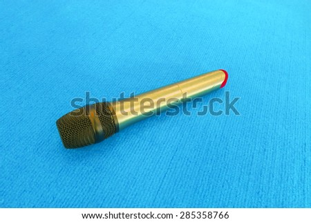 Microphone on a blue background. - stock photo