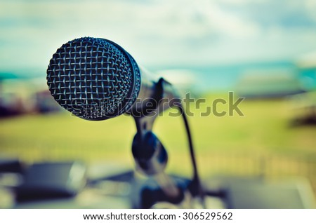 microphone on a stage outdoors - stock photo