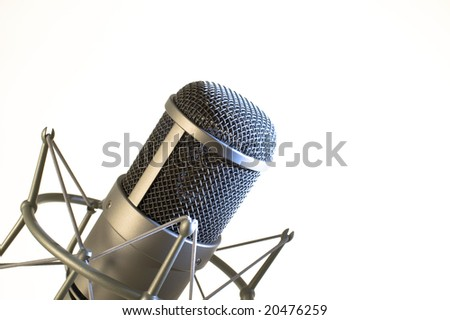 Microphone on a white background. - stock photo
