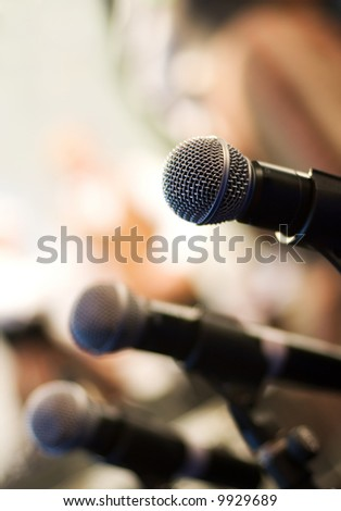 Microphone on abstract blurred background (shallow DoF) - stock photo