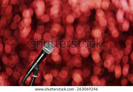 Microphone on bright red background - stock photo