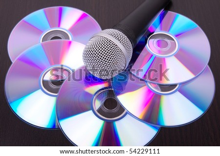Microphone on dvd disc, closed-up - stock photo