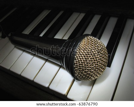 Microphone on piano - stock photo