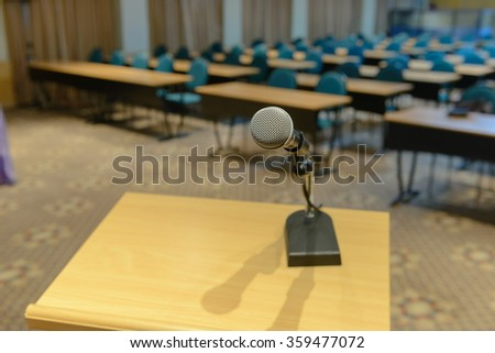 Microphone on podium in empty conference room - stock photo