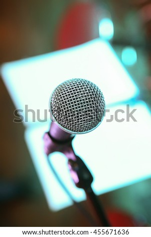 microphone on scene in night club close up - stock photo