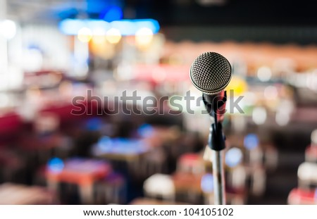 Microphone on stage in club with background - stock photo