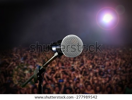 Microphone on stage with spotlight in concert - stock photo