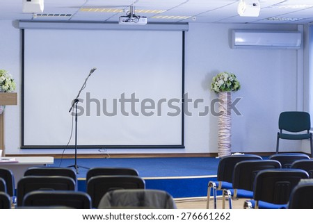 Microphone on Stand in Front of The Empty Auditorium. Horizontal Image Composition - stock photo