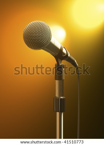 Microphone on stand with orange stage lights. - stock photo