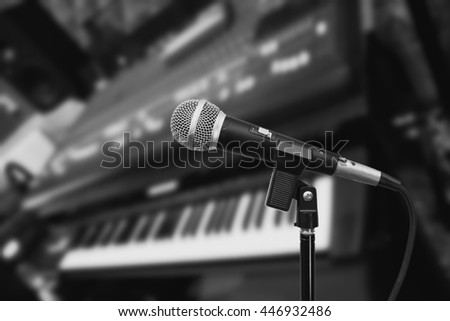 microphone on studio mixer & piano, bw filter