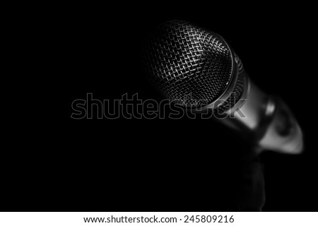 Microphone  on the black background. - stock photo