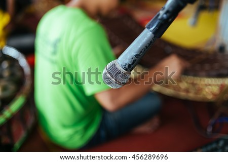 Microphone on the stand at the background of the Band Instruments Thailand - stock photo
