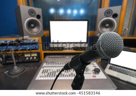 Microphone over the Abstract blurred photo of music studio recording room background, musical concept