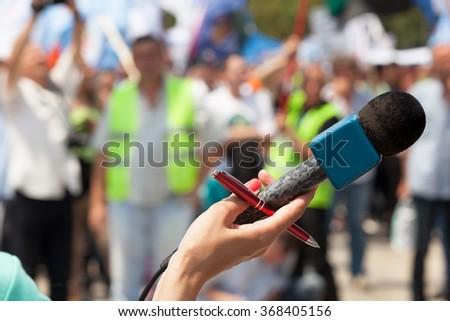 Microphone. Public demonstration. - stock photo