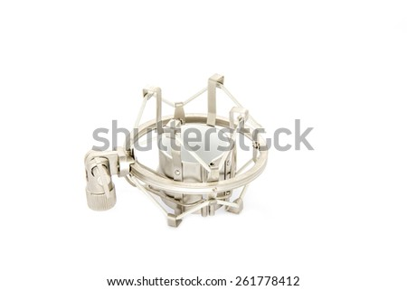 Microphone Shock mount on white microphone a shock mount helps reduce noise from the surrounding area, without affecting the sound of a microphone. - stock photo