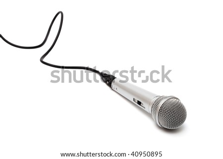 Microphone with a black cord on a white background - stock photo
