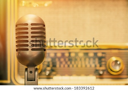 Microphone with an antique radio background - stock photo