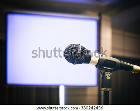 Microphone with Blank screen Background Conference Seminar Event in Meeting room   - stock photo
