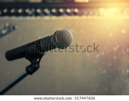 microphone with blurred Amp Speaker background ,vintage filter style