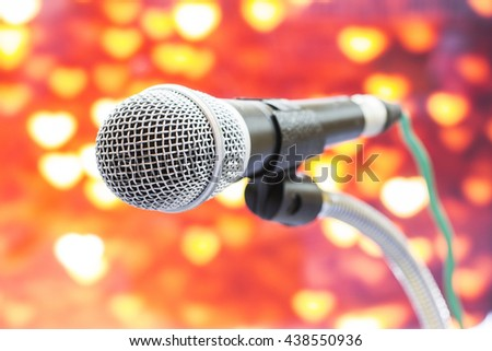 Microphone with bokeh background.