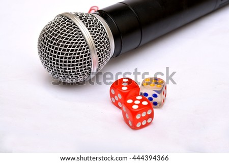 Microphone with dice - Motivational Speaker - stock photo