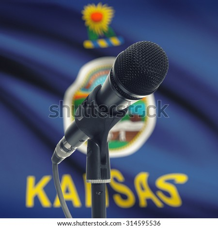 Microphone with US states flags on background series - Kansas - stock photo