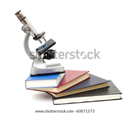 Microscope, books isolated on white - stock photo