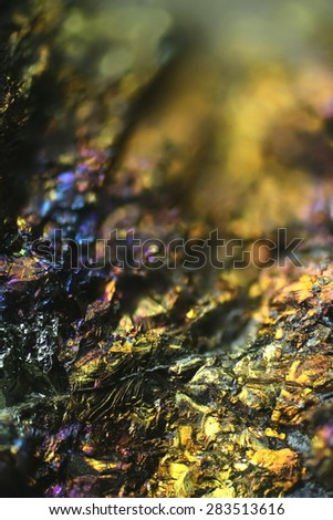 Microscope image of colorful  copper ore.   This is copper sulphide called Chalcopyrite, It has the chemical formula (CuFeS2).    Beautiful background for successful business projects.  - stock photo