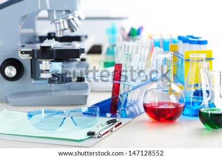 Microscope in a laboratory. Tools for research - stock photo