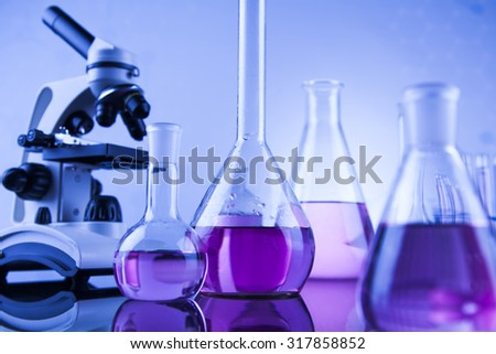 Microscope in medical laboratory glassware