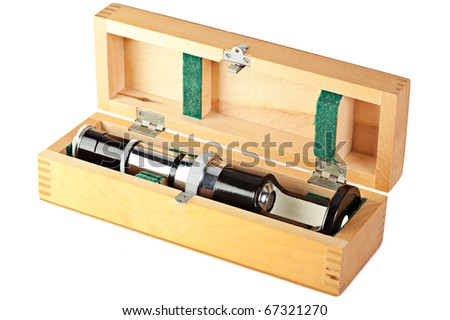 Microscope. Old fashioned mini microscope in wooden box isolated on white - stock photo