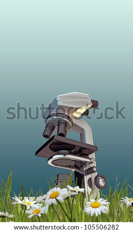 microscope on green grass - stock photo