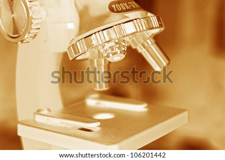 microscope sepia tones - stock photo