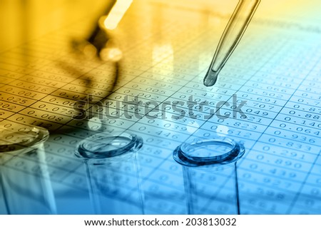 Microscope with biological material and test tubes. Blue tone. - stock photo
