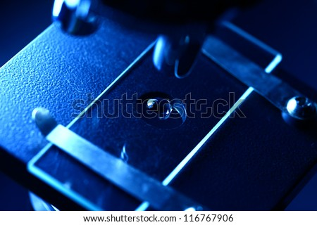 Microscope with biological material. Blue tone. - stock photo
