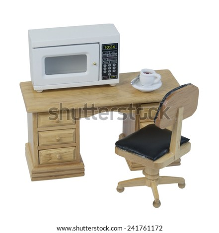 Microwave for quick cooking or heating of food items on desk with coffee - path included - stock photo