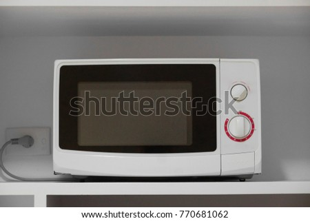 Microwave oven in a cupboard