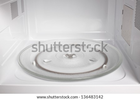 Microwave oven inside view - stock photo