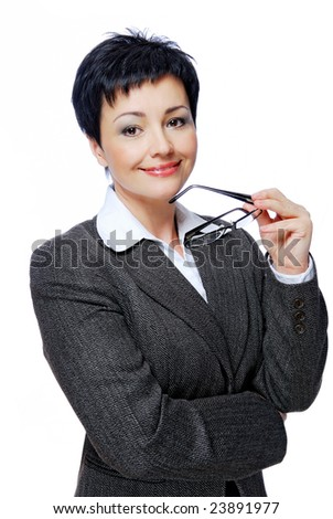 Mid adult businesswoman in grey business suit with glasses in hand - stock photo