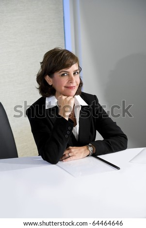 Mid-adult businesswoman, 40s, smiling with confidence at camera - stock photo