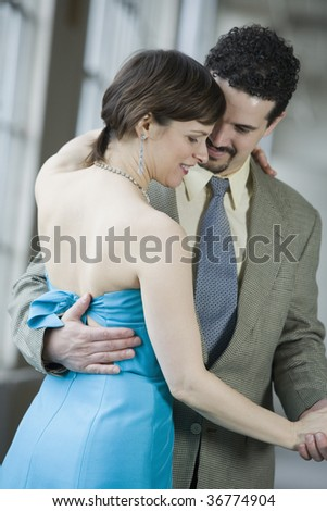 Mid adult couple dancing - stock photo